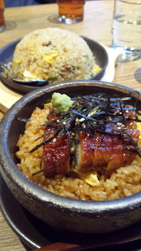 Eel in clay pot with rice in the background
